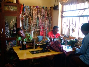 Widows making jewellery from paper